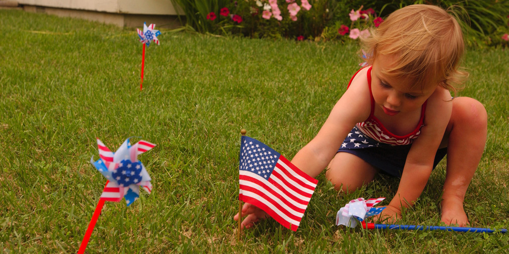 HIGHLANDS, NJ (July 18)--Cassidy James, 2, plants an American Flag in the front yard of the Redy home in Highlands NJ, shortly before her father, Quartermaster 1st Class Matt James, of the Coast Guard Cutter Adak, home ported in Sandy Hook, NJ., returns home from the war in Iraq July 18, 2003. James and Boatswain's Mate 1st Class Colin Redy both returned home from the war together.The Adak continues to patrol off the Iraqi coast. USCG photo by PA1 Tom Sperduto
