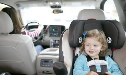 Young girl riding in rear-facing car seat