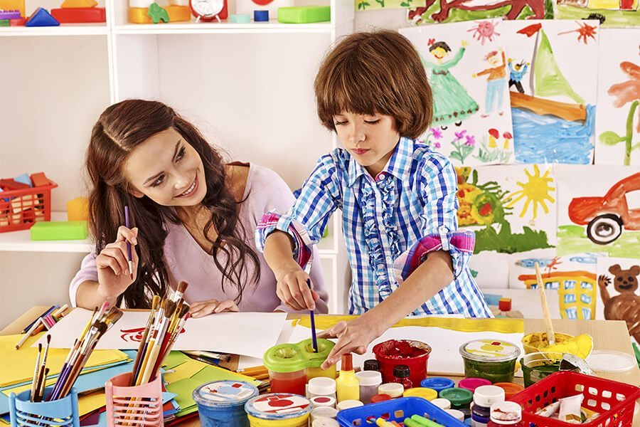 Teacher with Student at Art Table