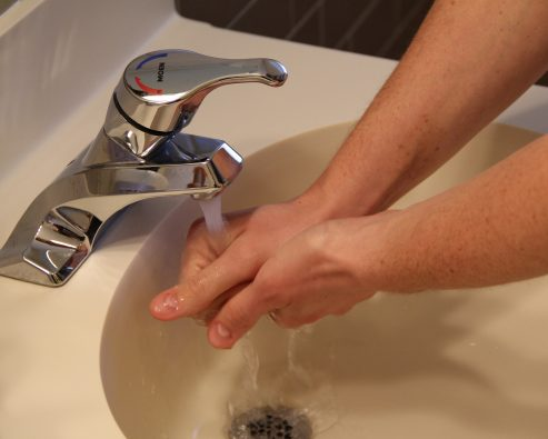 hand washing with water at sink
