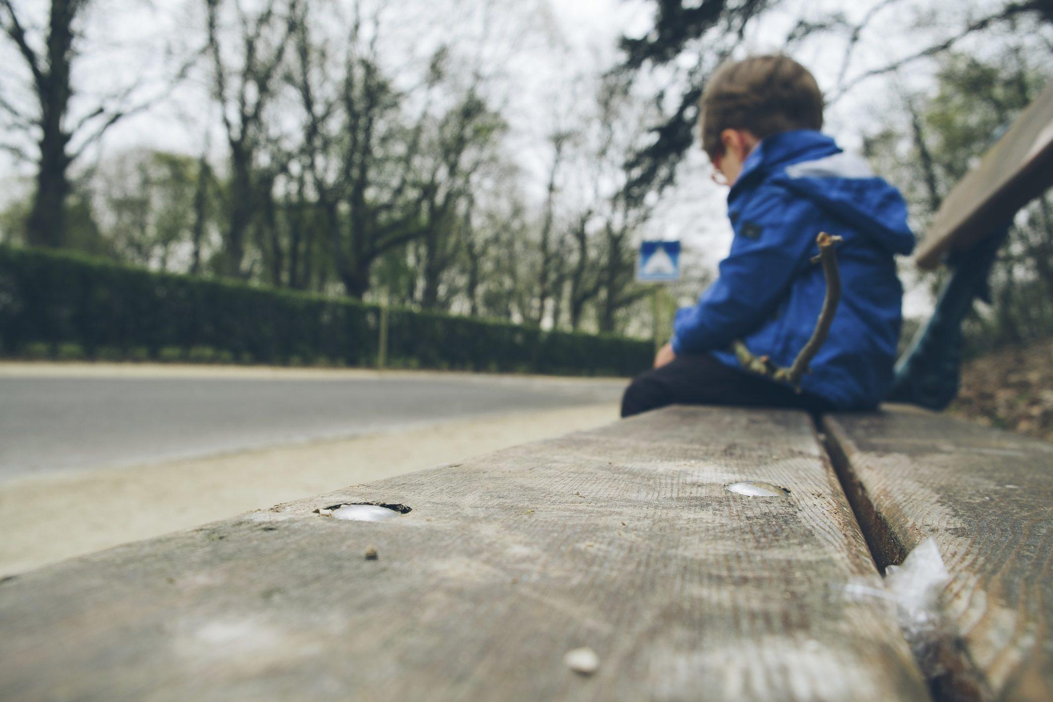sad boy on a bench