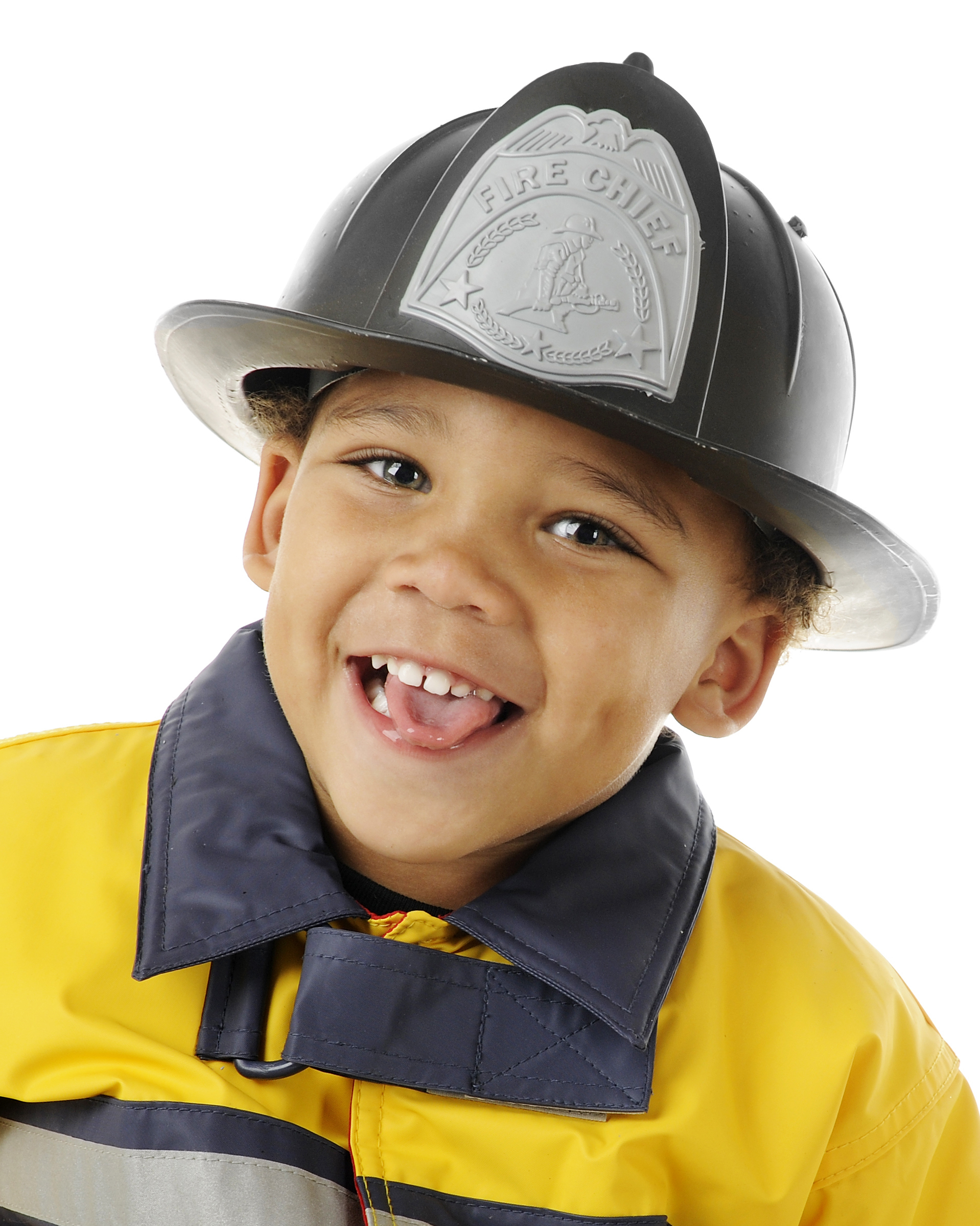 "Closeup image of an adorable preschool ""Fire Chief"" in his helmet and yellow coat. On a white background."