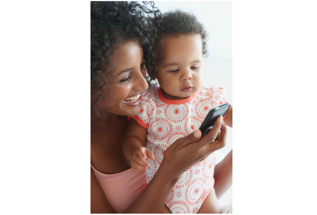 Mom and baby talking on cell phone