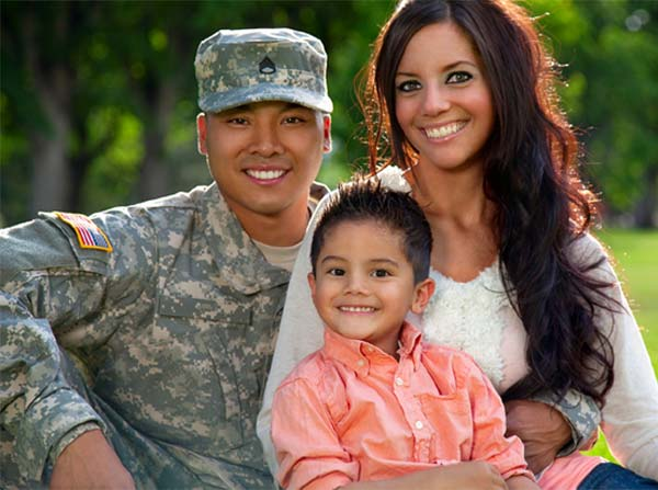 military family with man in uniform, his wife and their young son