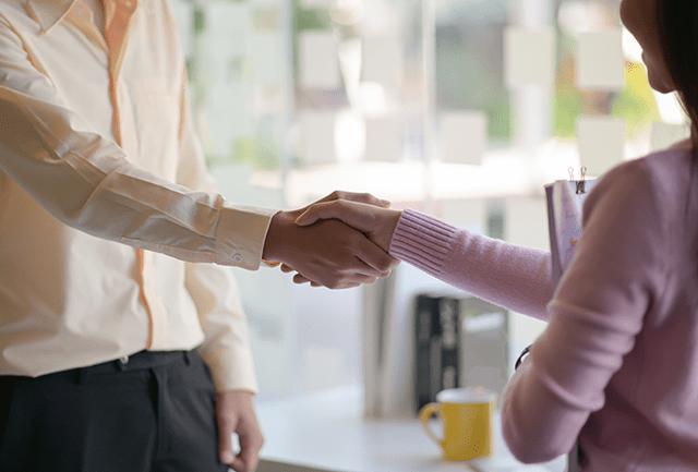shaking hands between colleagues