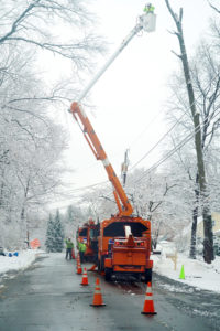 utility workers fix power line in ice storm