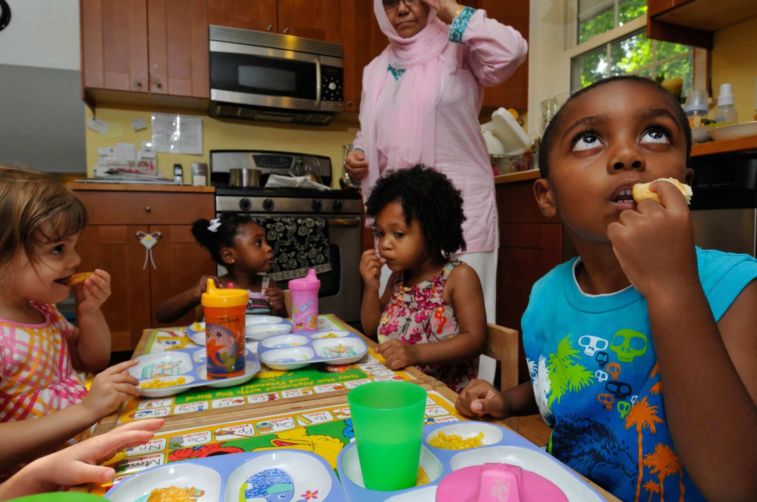 children gathered to eat in a family child care program